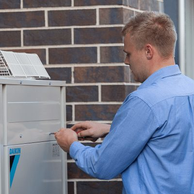Technician working on Daikin commercial air conditioning