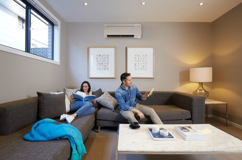 Couple enjoying air conditioning